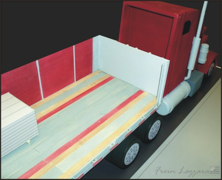 Scale model of tractor trailer to reenact unloading incident